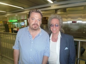 Jeffrey Gurian and Eddie Izzard waiting for their bags at baggage claim at La Guardia airport in NYC!