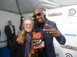 "Jeffrey Gurian with J.B. Smoove on the red carpet of Comedy Central's Night of Too Many Stars, holding Jeffrey's book """"Make 'Em Laugh"" , with an intro by Chris Rock!"