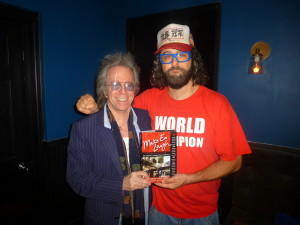 "Jeffrey Gurian with Judah Friedlander holding Jeffrey's book ""Make 'Em Laugh"", which he is in!"