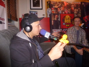 Luis J. Gomez holding a small yellow doll that he carries with him, and Dan Soder looking bemused!