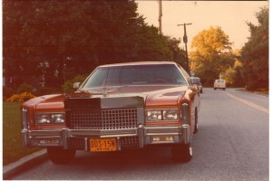The front of my Mandarin Orange Cadillac Eldorado, with the Rolls Royce Grille that had been made for one of the Isley Brothers, (with the D.D.S. plates!)