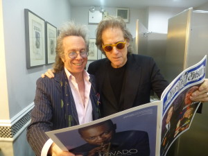 Jeffrey Gurian with Richard Lewis in the Men's Room of The Friars Club, reading an article about Jeffrey in the Friars Epistle.