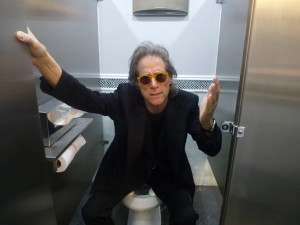 Richard Lewis on the toilet in the Men's Room of The Friars Club.