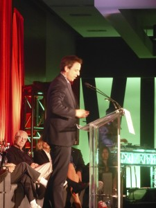 Seth Meyers at the podium at the Just for Laughs Festival presenting Amy Poehler with the Comedy Person of the Year Award!