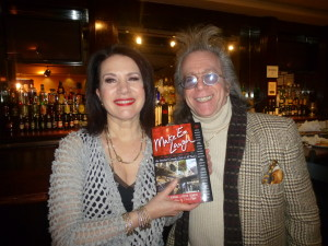 "Jeffrey Gurian with Susie Essman holding Jeffrey's book ""Make 'Em Laugh"" which she is in!"